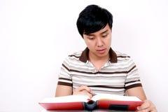 Giovane allievo asiatico con i libri. Immagine Stock Libera da Diritti