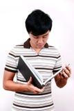 Giovane allievo asiatico con i libri. Fotografia Stock
