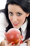 Giovane allievo che tiene una mela Fotografia Stock