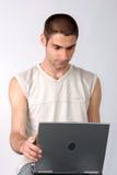 Giovane allievo con il computer portatile. Immagine Stock Libera da Diritti