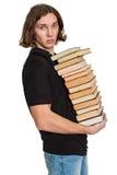 Giovane allievo con un mucchio dei libri Fotografie Stock Libere da Diritti