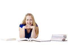 Giovane allievo femminile con i libri al pavimento Fotografie Stock Libere da Diritti
