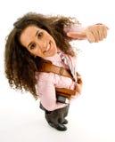 Giovane allievo femminile con i pollici in su Fotografia Stock