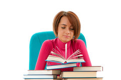 Giovane allievo femminile con molti libri Fotografia Stock