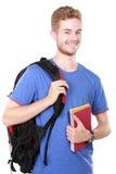 Giovane allievo maschio con i libri Immagine Stock