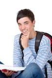 Giovane allievo maschio felice bello con il libro Fotografia Stock Libera da Diritti