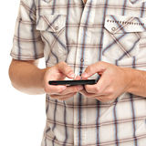 Giovane allievo vestito casuale Texting sul telefono delle cellule Fotografie Stock