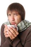 Giovane ammalato con una temperatura elevata Immagini Stock