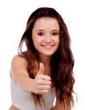 Giovane approvazione adolescente di detto con il fuoco sul suo pollice Fotografie Stock Libere da Diritti