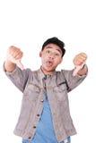 Giovane asiatico Guy Mocking Gesture con i pollici giù Fotografia Stock Libera da Diritti