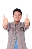 Giovane asiatico Guy Showing Two Thumbs Up Fotografia Stock Libera da Diritti