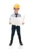 Giovane attrezzatura asiatica di Holding dell'ingegnere di costruzione del bambino Fotografia Stock