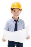Giovane attrezzatura asiatica di Holding dell'ingegnere di costruzione del bambino Immagine Stock Libera da Diritti