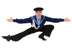 Giovane ballerino vestito come marinaio che posa su un fondo bianco isolato Fotografie Stock