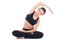 Giovane bella donna che fa allungando gli esercizi isolati sul whi Fotografie Stock Libere da Diritti