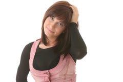 Giovane bella donna del brunet con l'espressione del fronte. Immagine Stock