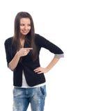 Giovane bella donna felice che indica su voi Immagini Stock Libere da Diritti