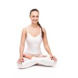 Giovane bella posa di yoga della donna Isolato Fotografie Stock