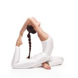 Giovane bella posa di yoga della donna Isolato Immagine Stock