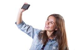 Giovane bella ragazza che fa una foto fotografia stock libera da diritti