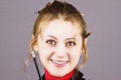 Giovane, bella ragazza con una matita Immagini Stock