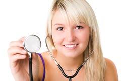 Giovane bella ragazza sorridente con lo stetoscopio Fotografia Stock