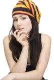 Giovane bella ragazza su priorità bassa bianca Fotografie Stock