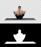 Giovane bello muscolare che risolve, yoga, loto, mani sul fronte, Alpha Channel fotografie stock