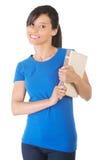 Giovane bello studente che tiene un libro Immagine Stock