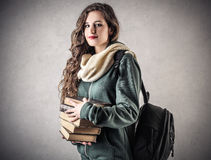 Giovane bello studente con i suoi libri Fotografie Stock Libere da Diritti