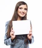 Giovane bordo sorridente della tenuta della donna di affari, porto bianco del fondo Fotografia Stock Libera da Diritti