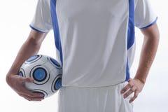 Giovane calciatore nell'azione fotografie stock libere da diritti