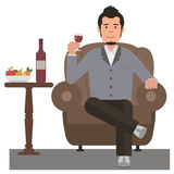 Giovane che beve vino rosso Fotografia Stock