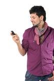Giovane che comunica sul telefono sul bianco Fotografia Stock Libera da Diritti