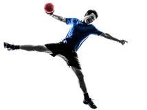 Giovane che esercita la siluetta del giocatore di pallamano immagini stock libere da diritti