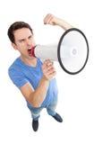 Giovane che grida tramite il megafono Immagini Stock