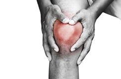 Giovane che ha dolore del ginocchio Fotografie Stock Libere da Diritti