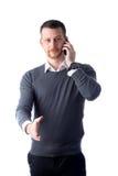 Giovane che parla sul telefono e che raggiunge fuori mano Immagini Stock Libere da Diritti
