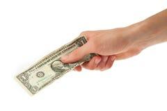 Giovane che tiene un dollaro in sua mano Fotografia Stock Libera da Diritti
