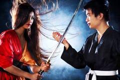 Giovane combattimento giapponese delle coppie Fotografie Stock Libere da Diritti