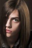 Giovane con capelli lunghi Immagini Stock Libere da Diritti