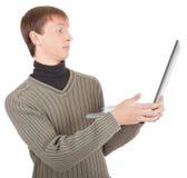 Giovane con il computer portatile immagine stock libera da diritti