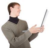 Giovane con il computer portatile immagine stock