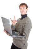 Giovane con il computer portatile fotografia stock