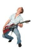 Giovane con il dancing della chitarra Fotografia Stock Libera da Diritti