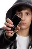 Giovane con il telefono mobile Fotografia Stock