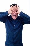Giovane con l'espressione divertente Fotografia Stock