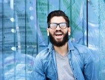 Giovane con la risata della barba Immagine Stock Libera da Diritti