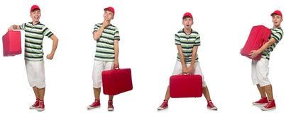 Giovane con la valigia rossa isolata su bianco fotografie stock