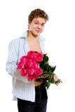 Giovane con le rose Immagini Stock